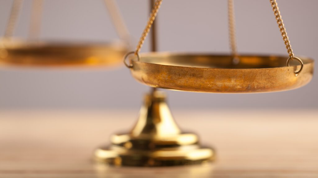 Law scales on table, close-up view
